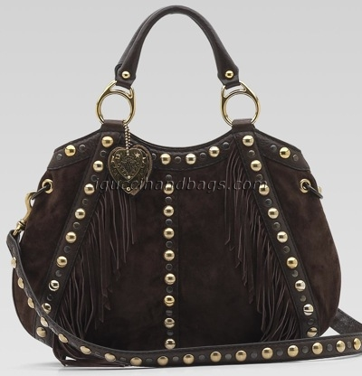 82da1be58fba This is one of my personal favorites – just check out the fringe detail and  the adorable Gucci crest charm! The bag also has detachable shoulder  straps, ...
